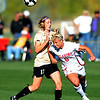 Lauren Alkek, right, of OU hits the ball away from Nikki Marshall of CU on Friday.<br /> Cliff Grassmick / October 2, 2009