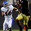 University of Colorado's Markques Simas completes a catch as University of Kansas's Chris Harris (16) defends during the game at Folsom Field in Boulder Saturday, Oct. 17, 2009. <br /> KASIA BROUSSALIAN / THE CAMERA