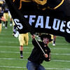 "A ""Ralphie Handler"" waves a University of Colorado flag as the team runs onto the field before kickoff against the University of Kansas at Folsom Field in Boulder Saturday, Oct. 17, 2009. <br /> KASIA BROUSSALIAN / THE CAMERA"