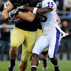 University of Colorado's Riar Geer (87) is tackled by University of Kansas's Daymond Patterson (15) during the game at Folsom Field in Boulder Saturday, Oct. 17, 2009. <br /> KASIA BROUSSALIAN / THE CAMERA