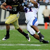 University of Colorado's Rodney Stewart (5) pushes past University of Kansas's Arist Wright (41) during the game at Folsom Field in Boulder Saturday, Oct. 17, 2009. <br /> KASIA BROUSSALIAN / THE CAMERA