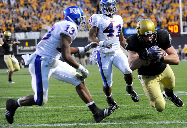 University of Colorado's Riar Geer (87) dives into the end zone for a touchdown University of Kansas's Lubbock Smith (13) and Arist Wright (41) defend during the game at Folsom Field in Boulder Saturday, Oct. 17, 2009. <br /> KASIA BROUSSALIAN / THE CAMERA