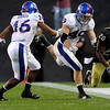 University of Colorado's Matt Meyer (20) is pushed out of bounds by University of Kansas's Drew Dudley (49) during the game at Folsom Field in Boulder Saturday, Oct. 17, 2009. <br /> KASIA BROUSSALIAN / THE CAMERA