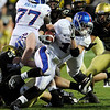 University of Kansas's Jake Sharp (1) dodges from Colorado defense during the game at Folsom Field in Boulder Saturday, Oct. 17, 2009. <br /> KASIA BROUSSALIAN / THE CAMERA
