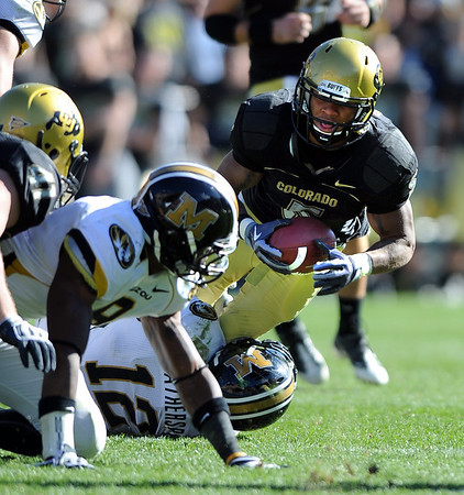 Rodney Stewart of CU is short of the first down on fourth down against Missouri.<br /> Cliff Grassmick / October 31, 2009