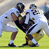 Scotty McKnight is wrapped up by Kevin Rutland (20) and another Missouri defender.<br /> Cliff Grassmick / October 31, 2009