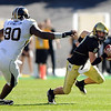 CU QB Tyler Hansen avoids the rush of Dominique Hamilton of Missouri on Saturday.<br /> Cliff Grassmick / October 31, 2009