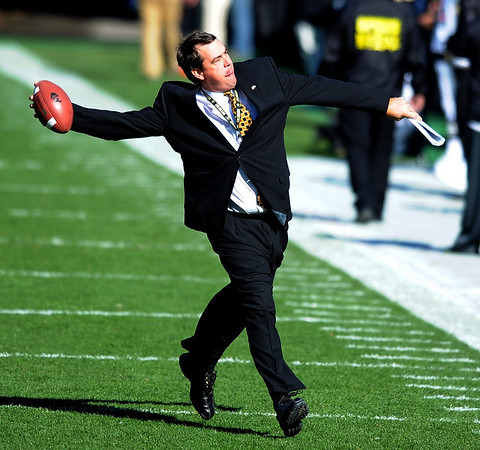 Colorado Athletic Director, Mike Bohn, throws a football into the CU student section before the Missouri game on Saturday.<br /> Cliff Grassmick / October 31, 2009