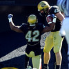 Ben Burney (42)  of CU celebrates his interception return for a touchdown with  Jeff Smart.<br /> Cliff Grassmick / October 31, 2009