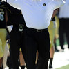Colorado football coach Dan Hawkins takes off the earphones in the first half of the Missouri game on Saturday.<br /> Cliff Grassmick / October 31, 2009