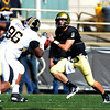 CU QB Tyler Hansen looks to pass around Jaron Baston of Missouri on Saturday.<br /> Cliff Grassmick / October 31, 2009