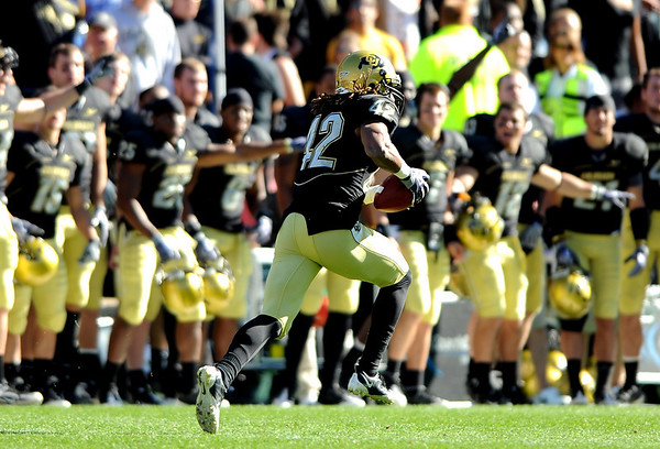The CU bench points the way for Ben Burney on his interception return for a score against Missouri.<br /> Cliff Grassmick / October 31, 2009