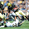 Brian Lockridge of Colorado is upended by Trey Hobson of Missouri.<br /> Cliff Grassmick / October 31, 2009