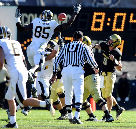 CU QB Tyler Hansen gets his pass batted down by Aldon Smith of Missouri.<br /> Cliff Grassmick / October 31, 2009