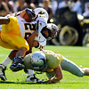 University of Colorado Buffalo's Patrick Mahnke (12) tackles University of Wyoming Cowboy's Brandon Stewart (22) during their game at Folsom Field in Boulder, Colorado on Saturday, Sept. 19, 2009.<br /> KASIA BROUSSALIAN / THE CAMERA