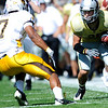 University of Colorado Buffalo's Scotty McKnight (21) is pushed out of bounds after completing a catch by University of Wyoming Cowboy's Shamiel Gary (7) during their game at Folsom Field in Boulder, Colorado on Saturday, Sept. 19, 2009.<br /> KASIA BROUSSALIAN / THE CAMERA