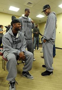 Dwight Thorne II, left,  jokes with Rick Higgins during CU basketball media days. Cliff Grassmick / October 16, 2009