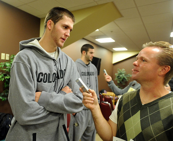 CU player Austin Dufault talks to  reporter Ryan Thorburn during media day.<br /> Cliff Grassmick / October 16, 2009