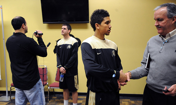 "New freshman, Askia Booker, right, talks to the press on basketball media day. Nate Tomlinson is interviewed in the background.<br /> For videos and photos of media day, go to  <a href=""http://www.dailycamera.com"">http://www.dailycamera.com</a><br /> Cliff Grassmick / October 26, 2011"
