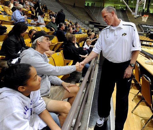 """Men's coach, Tad Boyle, introduces himself to Don Wahl, and daughter  Kaiya during the festivities.<br /> The University of Colorado basketball programs  held the CU Basketball Tip-Off  Festival on Sunday. For more photos, go to  <a href=""""http://www.dailycamera.com"""">http://www.dailycamera.com</a>.<br /> Cliff Grassmick / November 7, 2010"""