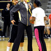 "Women's basketball coach, Linda Lappe, center, demonstrates a play with the help of Beth Laymen, left, and Ayesha Anderson during one of the activities.<br /> The University of Colorado basketball programs  held the CU Basketball Tip-Off  Festival on Sunday. For more photos, go to  <a href=""http://www.dailycamera.com"">http://www.dailycamera.com</a>.<br /> Cliff Grassmick / November 7, 2010"