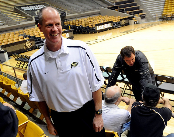 "Tad Boyle, CU men's coach, talks to people in the crowd, along with AD Mike Bohn, right.<br /> The University of Colorado basketball programs  held the CU Basketball Tip-Off  Festival on Sunday. For more photos, go to  <a href=""http://www.dailycamera.com"">http://www.dailycamera.com</a>.<br /> Cliff Grassmick / November 7, 2010"