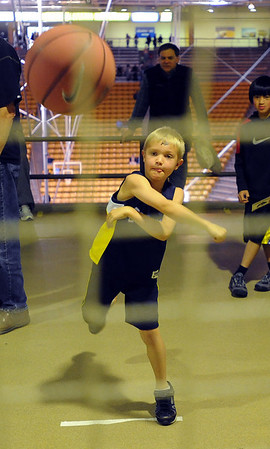 "Andrew Branan, 7, throws a pass during a skills drill during the festival.<br /> The University of Colorado basketball programs  held the CU Basketball Tip-Off  Festival on Sunday. For more photos, go to  <a href=""http://www.dailycamera.com"">http://www.dailycamera.com</a>.<br /> Cliff Grassmick / November 7, 2010"