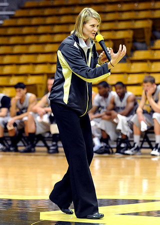 "Linda Lappe teaches a play to kids during the festival.<br /> The University of Colorado basketball programs  held the CU Basketball Tip-Off  Festival on Sunday. For more photos, go to  <a href=""http://www.dailycamera.com"">http://www.dailycamera.com</a>.<br /> Cliff Grassmick / November 7, 2010"