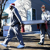 "University of Colorado's Carlon Brown, left, and Nate Tomlinson carry a present to a clients car while volunteering for the Share-A-Gift organization on Saturday, Dec. 17, at 4601 Nautilus Court in Boulder. For more photos and video  of the event go to  <a href=""http://www.dailycamera.com"">http://www.dailycamera.com</a><br /> Jeremy Papasso/ Camera"