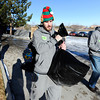 "University of Colorado's Nate Tomlinson, left, and Head Coach Tad Boyle carry presents to a clients car while volunteering for the Share-A-Gift organization on Saturday, Dec. 17, at 4601 Nautilus Court in Boulder. For more photos and video  of the event go to  <a href=""http://www.dailycamera.com"">http://www.dailycamera.com</a><br /> Jeremy Papasso/ Camera"