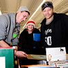 "University of Colorado's Shane Harris-Tunks, left, helps Rebecca Huggins, and her brother John Huggins pick out gifts for John's four children while volunteering for the Share-A-Gift organization on Saturday, Dec. 17, at 4601 Nautilus Court in Boulder. For more photos and video  of the event go to  <a href=""http://www.dailycamera.com"">http://www.dailycamera.com</a><br /> Jeremy Papasso/ Camera"