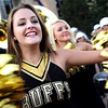 University of Colorado sophomore Courtney Lindau, left, performs for the crowd with the rest of the dance team during the Stampede on Friday, Sept. 16, on the Pearl Street Mall in Boulder.<br /> Jeremy Papasso/ Camera