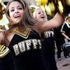 University of Colorado sophomore Courtney Lindau, middle, and freshman Megan Moren, right, perform with the dance team and the marching band during the Stampede on Friday, Sept. 16, on the Pearl Street Mall in Boulder.<br /> Jeremy Papasso/ Camera