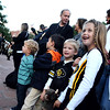 Peyton Strauss, 6, of Boulder, and her brother Grayson Strauss, 4, both of Boulder, smile as they watch the University of Colorado dance team and marching band perform during the Stampede on Friday, Sept. 16, on the Pearl Street Mall in Boulder.<br /> Jeremy Papasso/ Camera