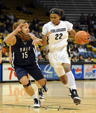"Brittany Spears of CU drives on Megan Vasquez of Yale on Monday.<br /> For more photos of the game, go to  <a href=""http://www.dailycamera.com"">http://www.dailycamera.com</a>.<br /> Cliff Grassmick / January 4, 2010"