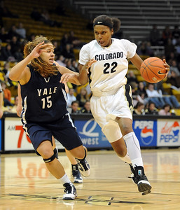 Brittany Spears of CU drives on Megan Vasquez of Yale on Monday. For more photos of the game, go to www.dailycamera.com. Cliff Grassmick / January 4, 2010