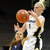 """Alyssa Fressle of CU grabs the ball in front of Megan Vasquez of Yale.<br /> For more photos of the game, go to  <a href=""""http://www.dailycamera.com"""">http://www.dailycamera.com</a>.<br /> Cliff Grassmick / January 4, 2010"""