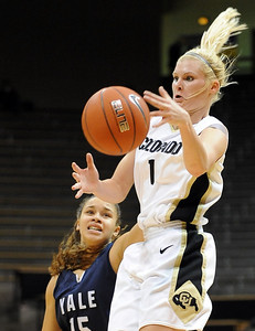 Alyssa Fressle of CU grabs the ball in front of Megan Vasquez of Yale. For more photos of the game, go to www.dailycamera.com. Cliff Grassmick / January 4, 2010