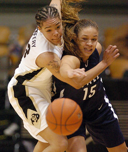 Chucky Jeffery of CU and Megan Vasquez (15) of Yale battle for a lose ball Monday night. For more photos of the game, go to www.dailycamera.com. Cliff Grassmick / January 4, 2010