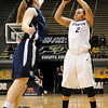 "Bianca Smith of Colorado puts up a three against Yale on Monday.<br /> For more photos of the game, go to  <a href=""http://www.dailycamera.com"">http://www.dailycamera.com</a>.<br /> Cliff Grassmick / January 4, 2010"