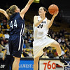 """Brenna Malcom-Peck of CU shoots over Michelle Cashen of Yale.<br /> For more photos of the game, go to  <a href=""""http://www.dailycamera.com"""">http://www.dailycamera.com</a>.<br /> Cliff Grassmick / January 4, 2010"""