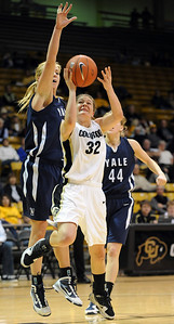 Kelly Jo Mullaney of Colorado goes under Mady Gobrecht of Yale. For more photos of the game, go to www.dailycamera.com. Cliff Grassmick / January 4, 2010