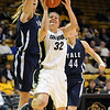 """Kelly Jo Mullaney of Colorado goes under Mady Gobrecht of Yale.<br /> For more photos of the game, go to  <a href=""""http://www.dailycamera.com"""">http://www.dailycamera.com</a>.<br /> Cliff Grassmick / January 4, 2010"""