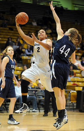 "Bianca Smith of CU drives around Michelle Cashen of Yale on Monday.<br /> For more photos of the game, go to  <a href=""http://www.dailycamera.com"">http://www.dailycamera.com</a>.<br /> Cliff Grassmick / January 4, 2010"