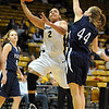"""Bianca Smith of CU drives around Michelle Cashen of Yale on Monday.<br /> For more photos of the game, go to  <a href=""""http://www.dailycamera.com"""">http://www.dailycamera.com</a>.<br /> Cliff Grassmick / January 4, 2010"""
