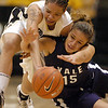 "Chucky Jeffery of CU and Megan Vasquez (15) of Yale battle for a lose ball Monday night.<br /> For more photos of the game, go to  <a href=""http://www.dailycamera.com"">http://www.dailycamera.com</a>.<br /> Cliff Grassmick / January 4, 2010"