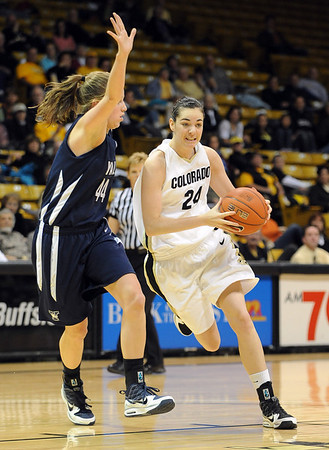 "Brenna Malcom-Peck of CU drives around Michelle Cashen of Yale.<br /> For more photos of the game, go to  <a href=""http://www.dailycamera.com"">http://www.dailycamera.com</a>.<br /> Cliff Grassmick / January 4, 2010"