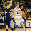 """Brenna Malcom-Peck of CU drives around Michelle Cashen of Yale.<br /> For more photos of the game, go to  <a href=""""http://www.dailycamera.com"""">http://www.dailycamera.com</a>.<br /> Cliff Grassmick / January 4, 2010"""