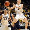 "Alyssa Fressle of CU flips up a shot against Yale Monday night.<br /> For more photos of the game, go to  <a href=""http://www.dailycamera.com"">http://www.dailycamera.com</a>.<br /> Cliff Grassmick / January 4, 2010"