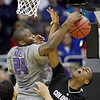 Kansas State forward Curtis Kelly (24) and Colorado guard Alec Burks (10) battle for a rebound during the second half of an NCAA college basketball game in the Big 12 men's basketball tournament Thursday, March 10, 2011 in Kansas City, Mo. Colorado won the game 87-75. (AP Photo/Charlie Riedel)